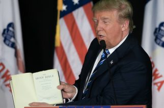 Republican presidential candidate Donald Trump displays his bible during a campaign stop in Council Bluffs, Iowa, Tuesday, Dec. 29, 2015. (AP Photo/Nati Harnik)
