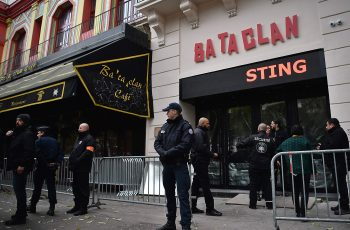 French policemen and security officers stand guard at the entrance of the Bataclan concert hall in Paris on November 12, 2016, a few hours before the reopening concert by British musician Sting to mark the first anniversary of the November 13 Paris attacks. Rock star Sting reopens the Bataclan on November 12, the revered Paris concert hall where jihadists massacred 90 people, with a hugely symbolic show to mark the first anniversary of France's bloodiest terror attacks. Scores of survivors of the Bataclan assault -- the worst of the gun and suicide attacks across the city that night which left 130 dead -- will attend the concert, the dominant event in a weekend of otherwise low-key commemorations.  / AFP PHOTO / PHILIPPE LOPEZPHILIPPE LOPEZ/AFP/Getty Images